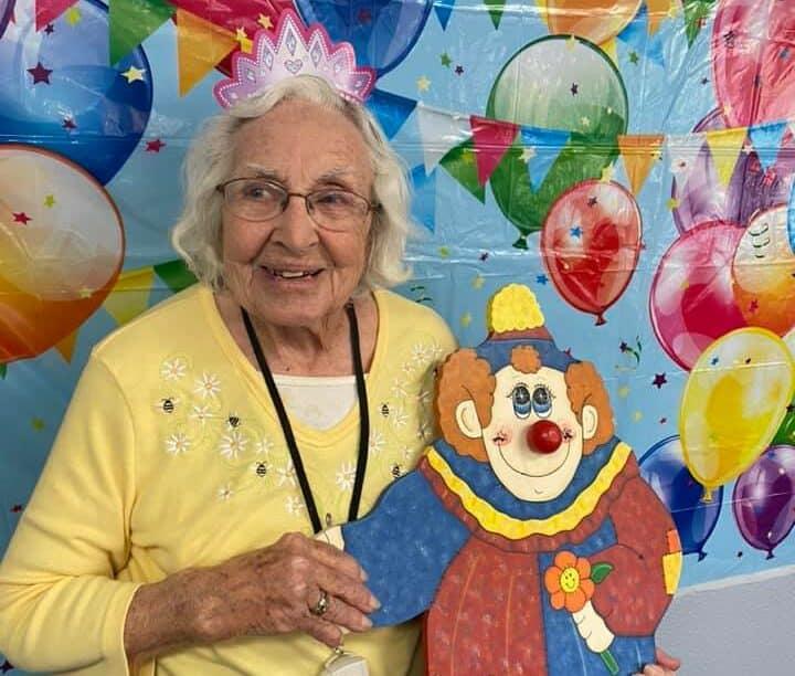 senior woman at a birthday party at cottonwood village in cottonwood, arizona