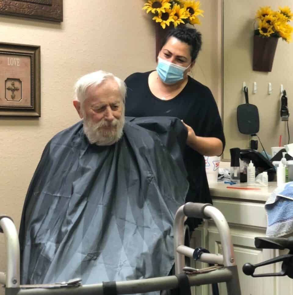 Senior man at the salon on-site at a senior living facility in Stephenville, Texas.