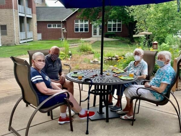 Group of seniors sitting outside at a senior living community in Fitchburg, Wisconsin.