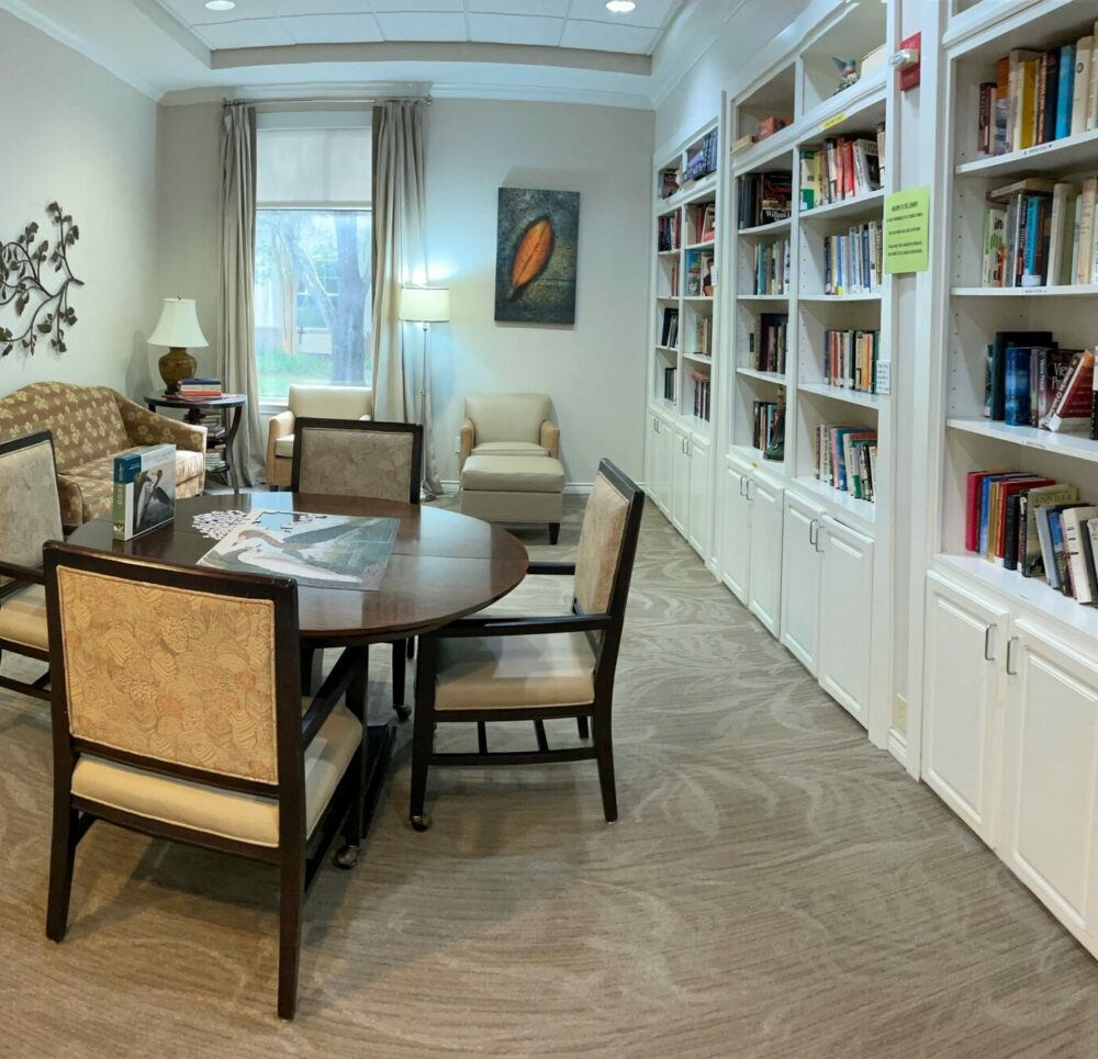 Library with seating area at the Waterford on Highland Colony, a senior living community in Ridgeland, Mississippi.