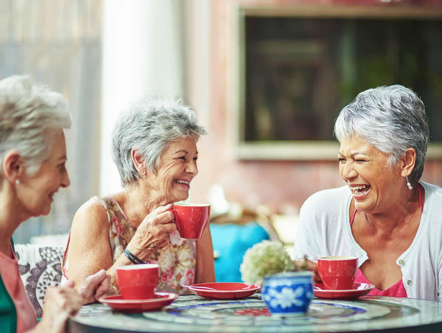 An image of three Myrtle Beach Estates residents enjoying coffee.