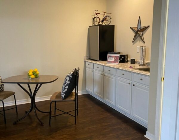 small kitchen area within an apartment at the waterford at carpenters creek