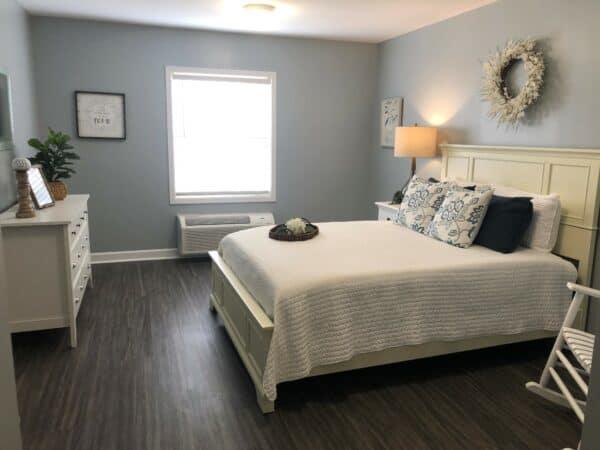 Senior apartment bedroom at North Pointe, a senior living community in Anderson, South Carolina.
