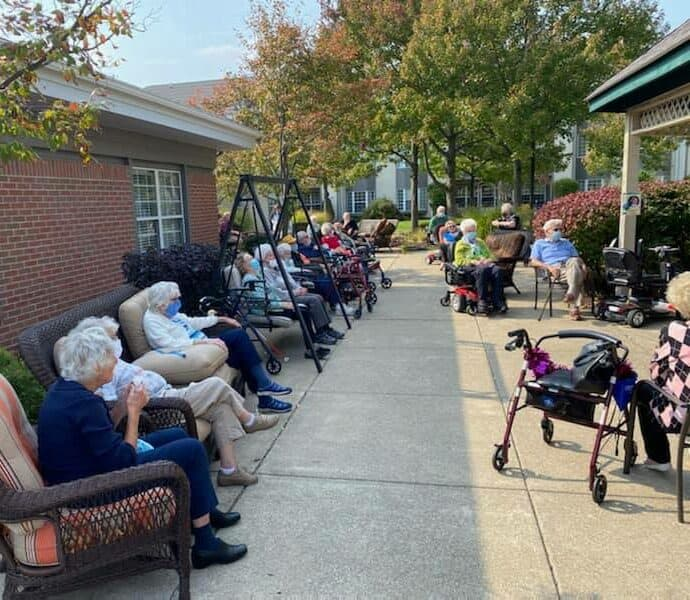 large gathering of elderly people outside on a patio