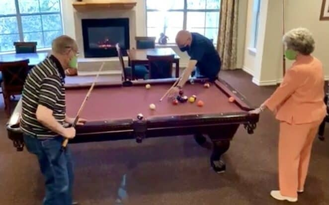 the remington at valley ranch, located in Irving, Texas, has a billiards table for seniors to enjoy