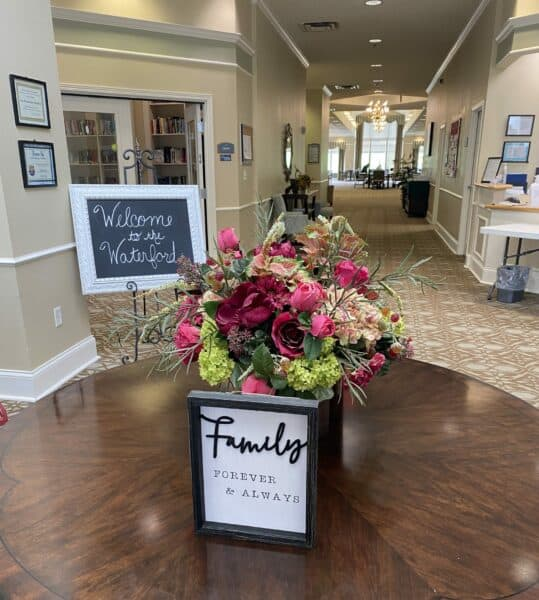 Lobby area with welcome sign at the Waterford at Mansfield, a senior living community in Mansfield, Ohio.