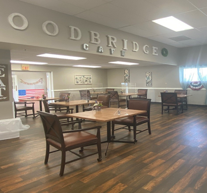 Large dining room with tables and chairs at a senior living community in Plattsmouth, Nebraska.