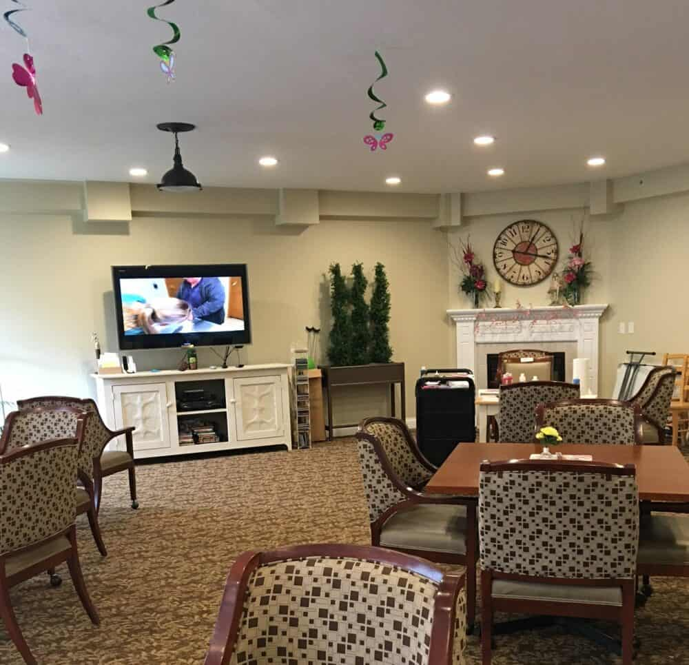 activity center with seating and a TV at Wynnfield Crossing, a senior community in Rochester, Indiana
