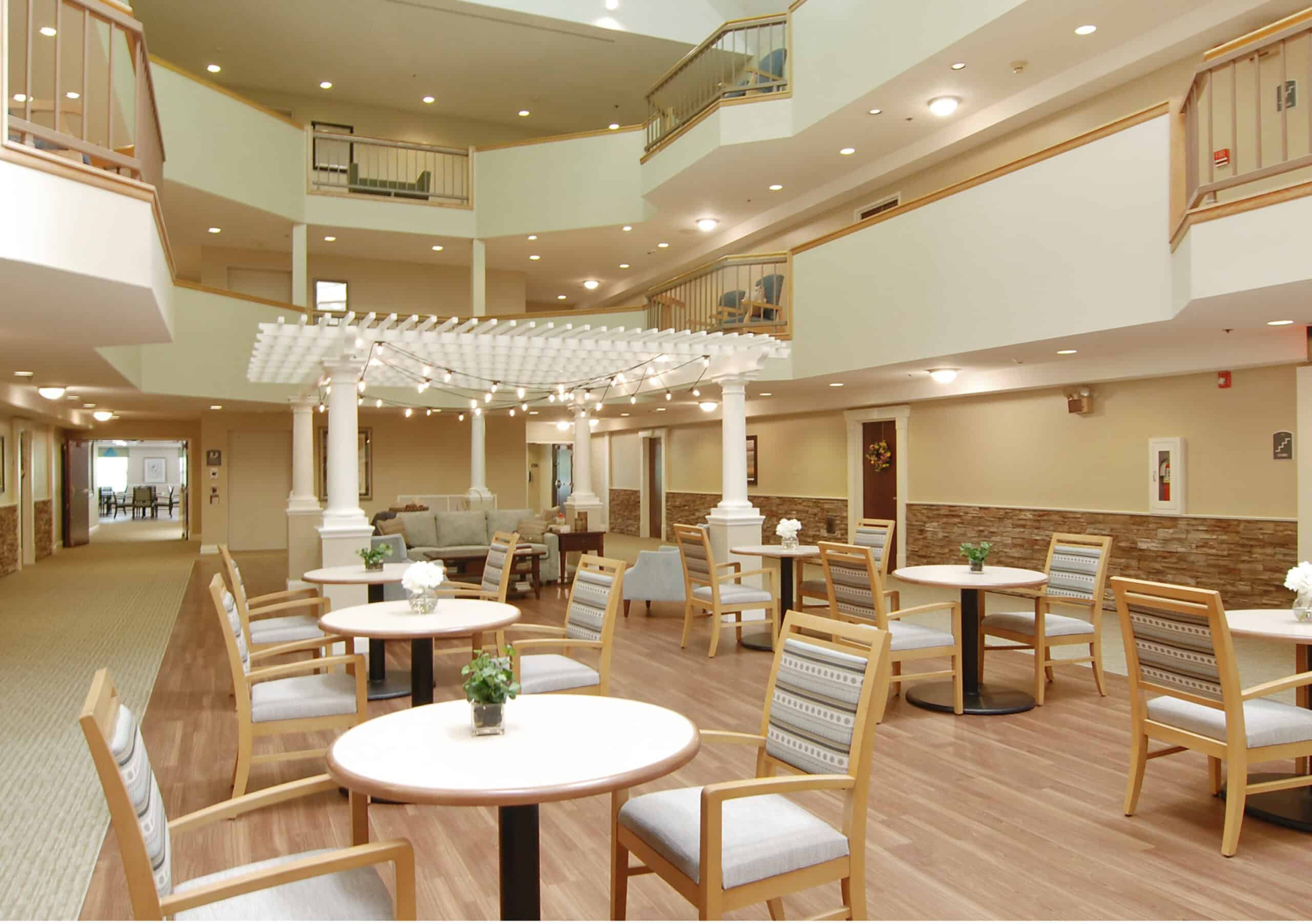 Three story atrium with in-door gazebo and plenty of seating for residents to socialize.