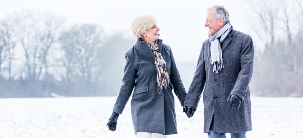 Senior couple having walk in winter