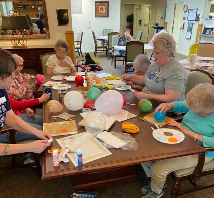 group of senior women doing a craft project