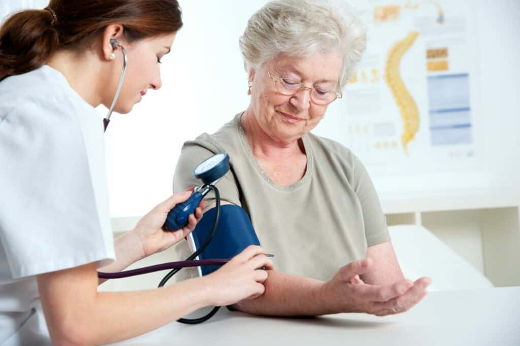 Senior woman getting her blood pressure taken.
