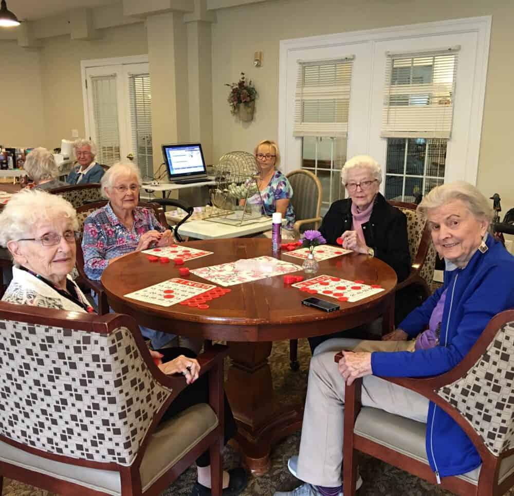 senior women play a game of bingo at Wynnfield Crossing, a senior community in Rochester, Indiana