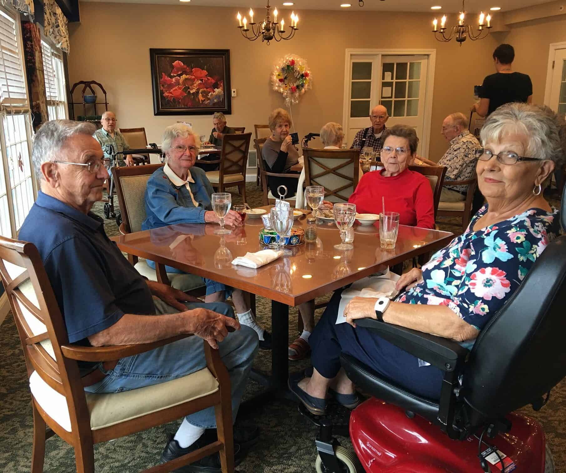four seniors eat together at Wynnfield Crossing, a senior community in Rochester, Indiana