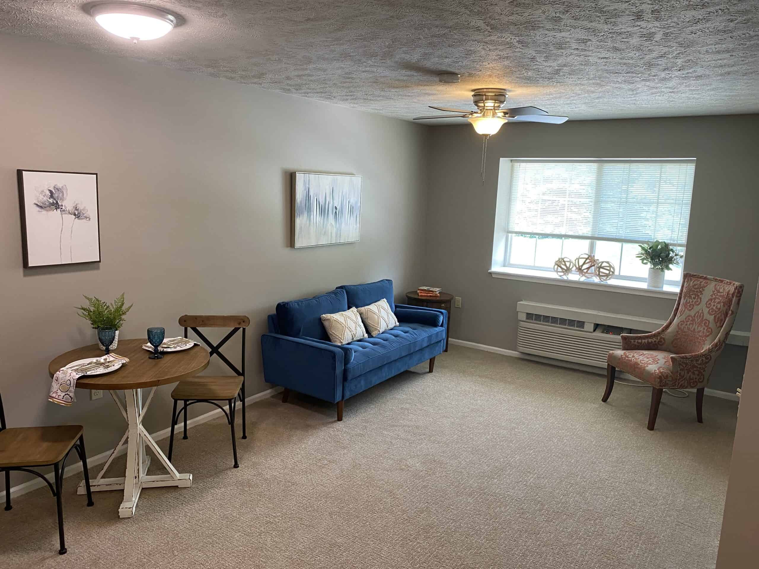 apartment living room at the waterford at miracle hills in nebraska