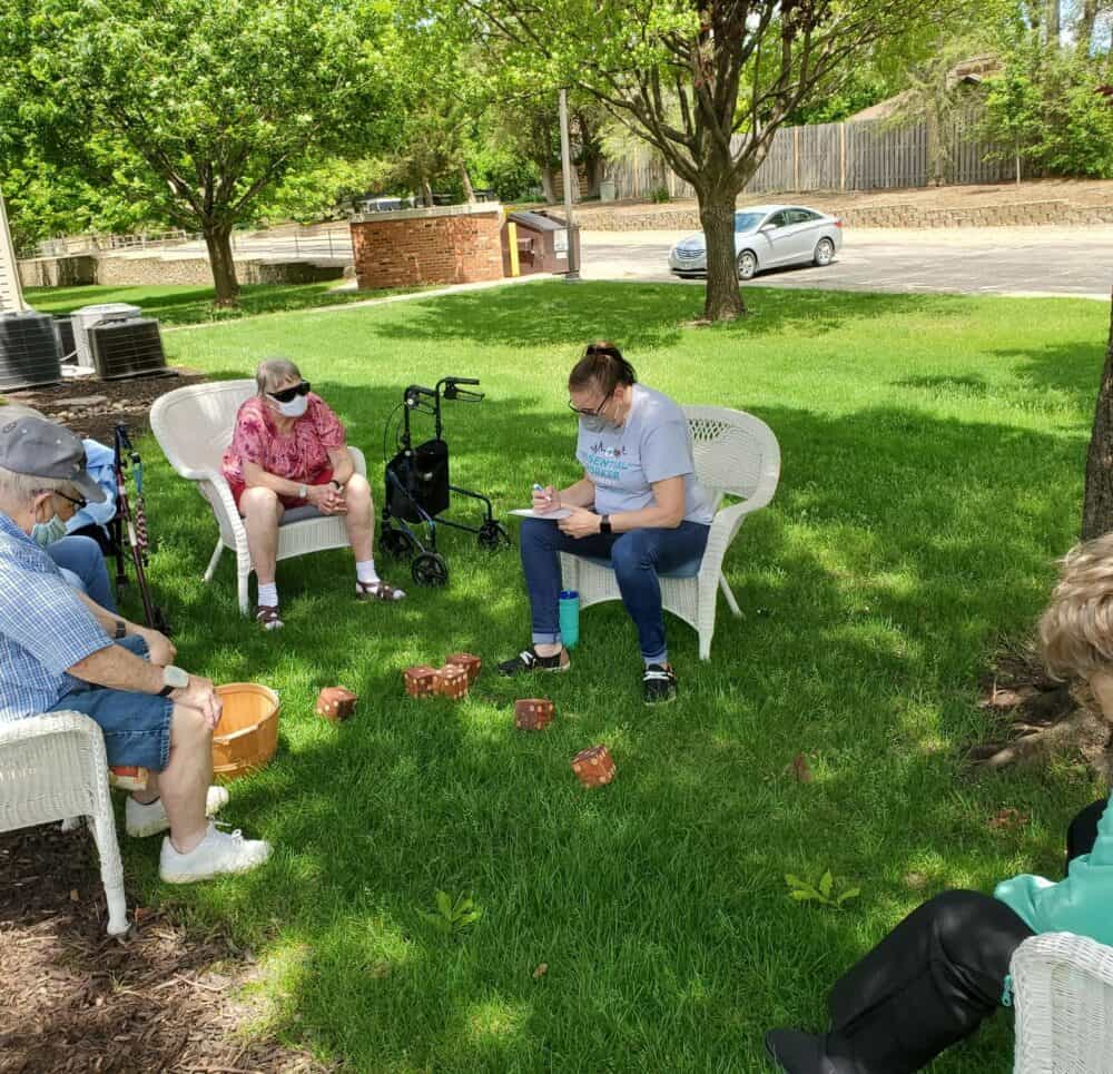 Seniors playing a game of dice outside at a senior living facility in Lincoln, Nebraska.